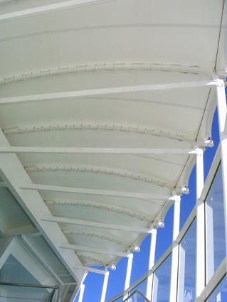 Textile canopy on a stairway by ACS Production, sun shade structure, tensioned fabric canopy