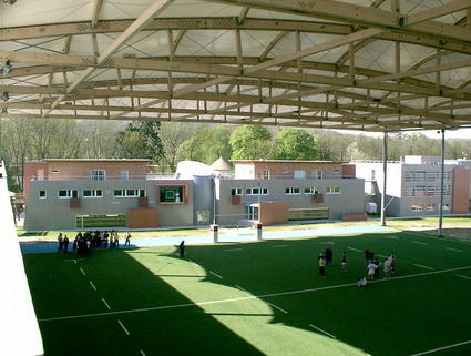 Fabric architecture for multi sports playgrounds by ACS Production Sun shade Tetile Architecture with Ferrari fabric